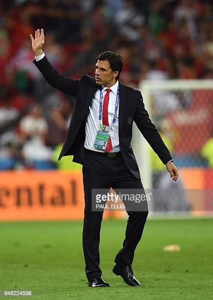 Wales' coach Chris Coleman reacts at the end of the Euro 2016 semifinal football match between Portugal and Wales at the Parc Olympique Lyonnais...