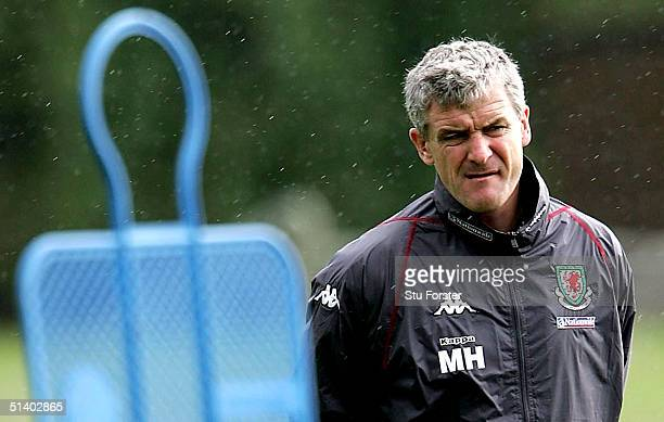 Wales coach Mark Hughes looks on during Wales Football training ahead of the World Cup qualifying match against England at the University of...