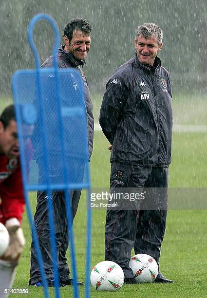 Wales coach Mark Hughes shares a joke with equipment manager Tony Quaglia during Wales Football training ahead of the World Cup qualifying match...