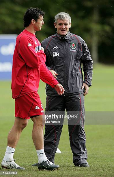 Wales coach Mark Hughes with Gary Speed during Wales Football training today ahead of this weekends game against England at the University of...
