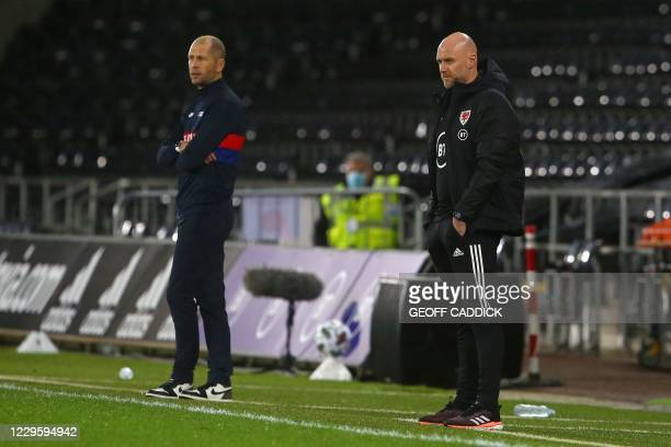 Wales' Coach Rob Page looks on from the sidelines alongside U.S Coach Gregg Berhalter during the international friendly football match between Wales...