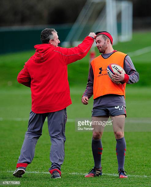 Wales coach Robert Howley playfully takes the wooly hat off Leigh Halfpenny's head during Wales training ahead of their RBS six nations match against...