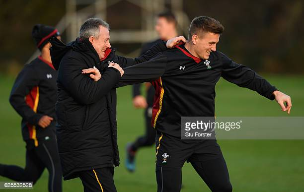 Wales coach Robert Howley shares a joke with centre Jonathan Davies during Wales training ahead of their match against South Africa at the Vale on...