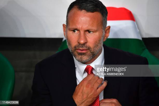 Wales' coach Ryan Giggs adjusts his tie prior to the UEFA Euro 2020 qualifier Group E football match Hungary against Wales on June 11 2019 in Budapest