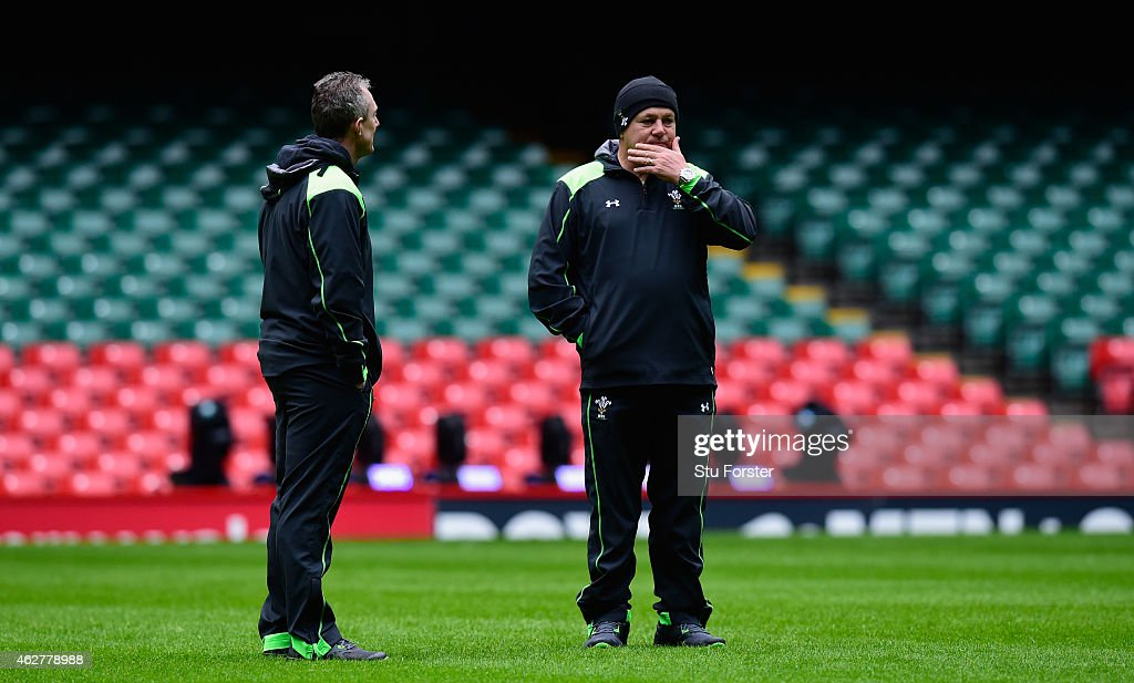 Wales coach Warren Gatland (r) and Robert Howley look on during Wales training ahead of friday's opening Six Nations match against England at Millennium Stadium on February 5, 2015 in Cardiff, Wales.