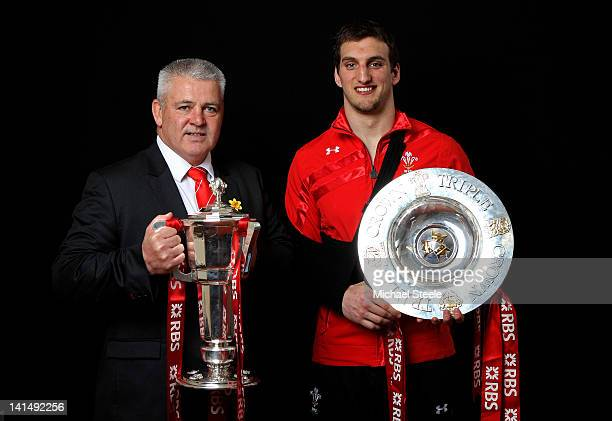 Wales coach Warren Gatland and Wales captain Sam Warburton pose with the Six Nations Trophy and the Triple Crown trophy during the RBS Six Nations...