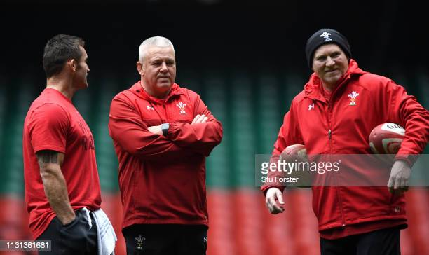 Wales coach Warren Gatland chats with coaches Huw Bennett and Neil Jenkins during Wales training ahead of the Six Nations match against England at...