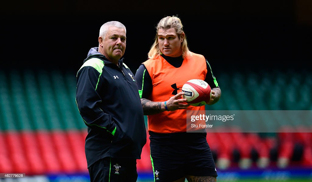 Wales coach Warren Gatland (l) chats with hooker Richard Hibbard during Wales training ahead of friday's opening Six Nations match against England at Millennium Stadium on February 5, 2015 in Cardiff, Wales.