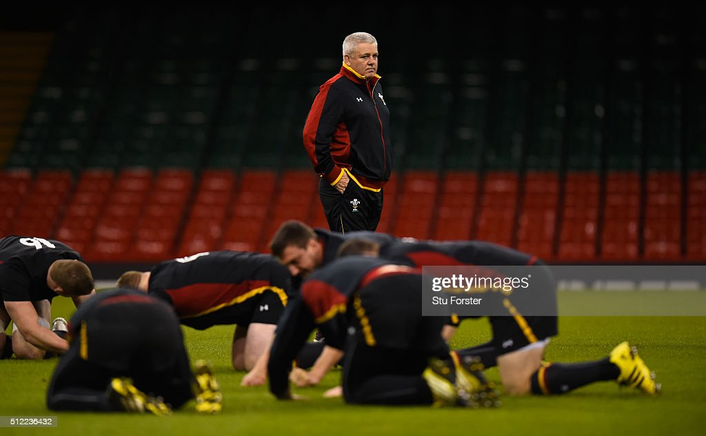 Wales coach Warren Gatland (c) looks on as his team stretch during the Wales captain's run ahead of their RBS Six Nations match against France at Principality Stadium on February 25, 2016 in Cardiff, Wales.