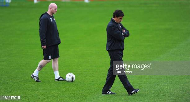 Wales coaches John Hartson and Chris Coleman look on during Wales training ahead of their World Cup qualifier against Belguim tomorrow night at the...