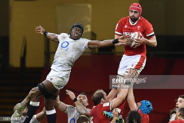 Wales' Cory Hill wins the ball from England's lock Maro Itoje in the line-out during the Six Nations international rugby union match between Wales...