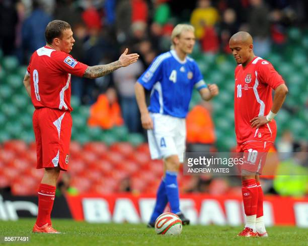 Wales' Craig Bellamy and Wales' Rob Earnshaw react after Finland's second goal during the FIFA World Cup 2010 European Qualifying Group Four football...