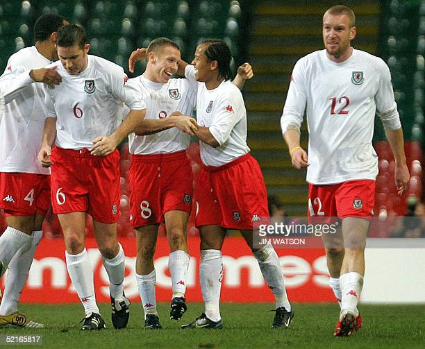 Wales' Craig Bellamy is hugged by Robert Earnshaw after Bellamy scored a second goal against Hungary during the Wales v Hungary International...