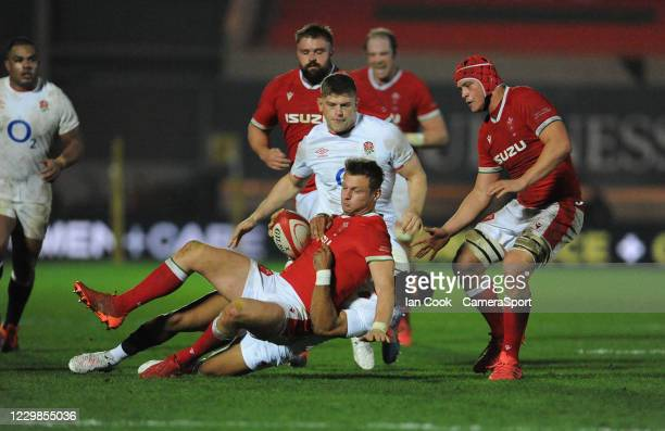 Wales Dan Biggar is tackled by England's Anthony Watson during the Quilter International match between Wales and England as part of the Autumn...