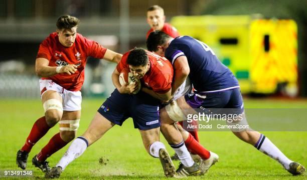 Wales' Dan Davies is tackled by Scotland's Shaun Gunn and Ewan Johnson during the U20 Men's 6 Nation Championships Round 1 match between Wales U20s...