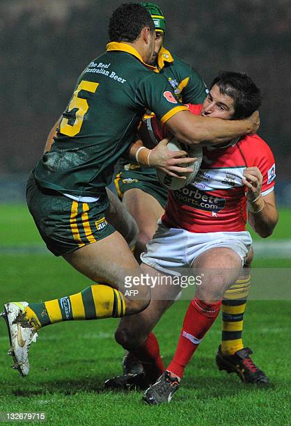 Wales' Danny Jones is tackled by Australia's Jharal Yow Yeh during a Four Nations rugby league test match between Wales and Australia at The...