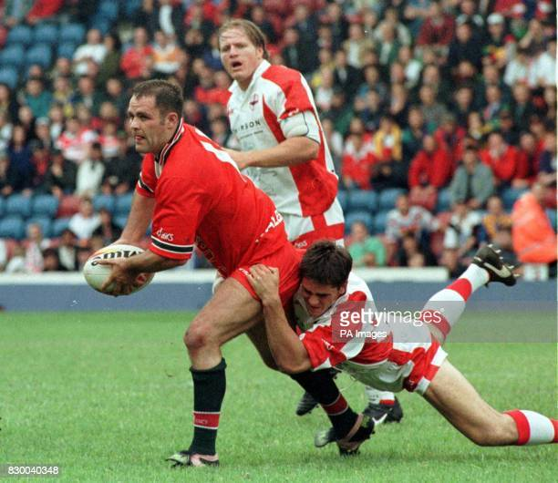 Wales' Dean Busby breaks through during their Thomson ESG match against England at the Auto Quest Stadium Widnes today Photo by Jeff Morris See PA...