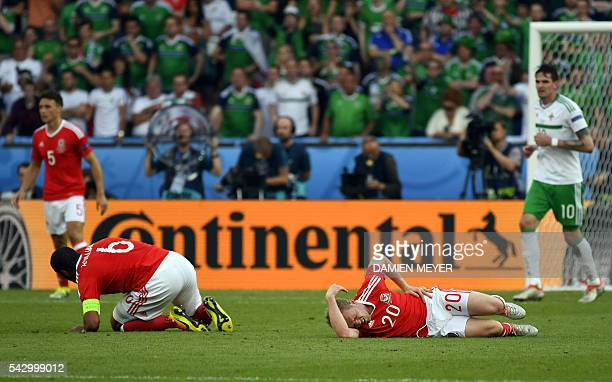 Wales' defender Ashley Williams and Wales' midfielder Jonathan Williams recover after clashing during the Euro 2016 round of sixteen football match...