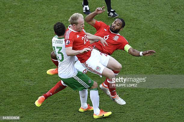 Wales' defender Ashley Williams and Wales' midfielder Jonathan Williams clash during a tackle with Northern Ireland's midfielder Corry Evans during...