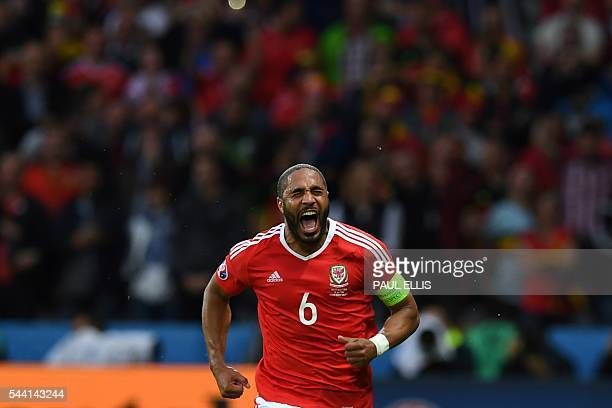 TOPSHOT Wales' defender Ashley Williams celebrates after scoring a goal during the Euro 2016 quarterfinal football match between Wales and Belgium at...