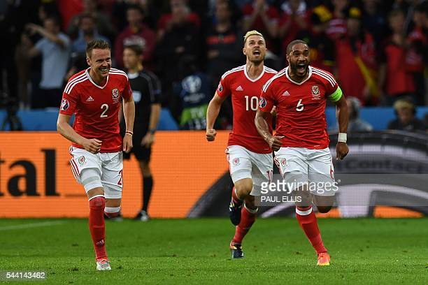 Wales' defender Ashley Williams celebrates after scoring a goal with Wales' defender Chris Gunter and Wales' midfielder Aaron Ramsey during the Euro...