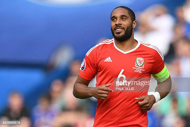 Wales' defender Ashley Williams runs during the Euro 2016 round of sixteen football match Wales vs Northern Ireland on June 25 2016 at the Parc des...