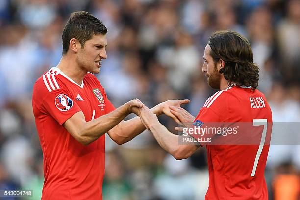 Wales' defender Ben Davies and Wales' midfielder Joe Allen celebrate their team's victory during the Euro 2016 round of sixteen football match Wales...