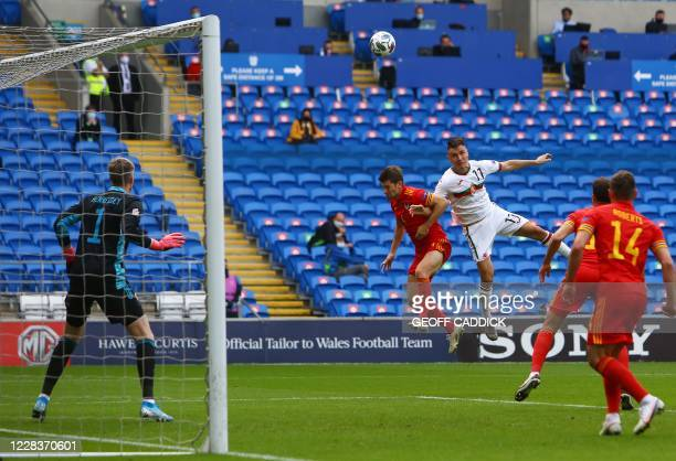 Wales' defender Ben Davies jumps with Bulgaria's midfielder Yanis Karabelyov during the UEFA Nations League football match between Wales and Bulgaria...