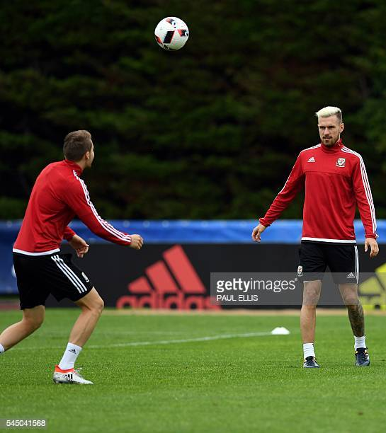 Wales' defender Chris Gunter and Wales' midfielder Aaron Ramsey take part in a training session in Dinard northwestern France on July 5 a day ahead...