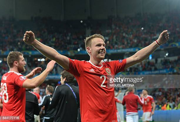 Wales' defender Chris Gunter celebrates at the end of the Euro 2016 quarterfinal football match between Wales and Belgium at the PierreMauroy stadium...