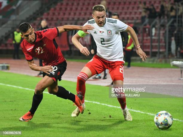 Wales' defender Chris Gunter vies for the ball with Albania's forward Myrto Uzuni during the friendly football match between Albania and Wales at the...