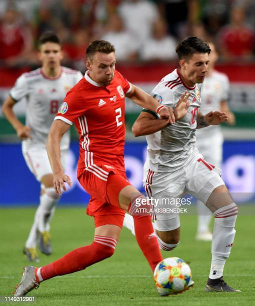 Wales' defender Chris Gunter vies with Hungary's midfielder Dominik Szoboszlai during the UEFA Euro 2020 Group E qualification football match Hungary...