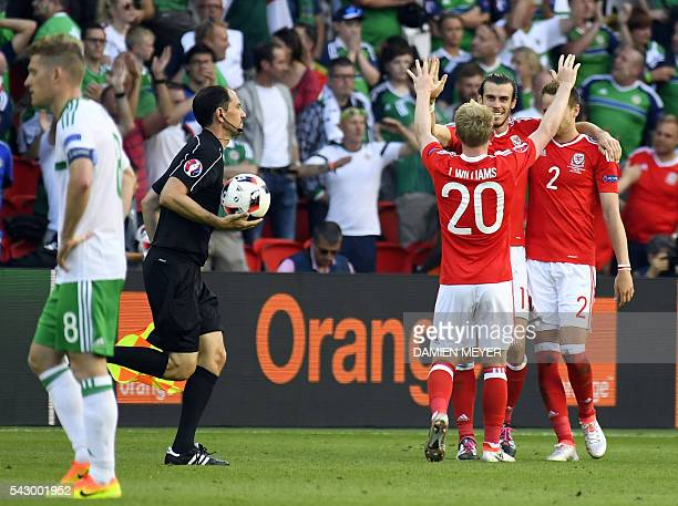 Wales' defender Chris Gunter Wales' forward Gareth Bale and Wales' midfielder Jonathan Williams celebrate after a 10 victory following the Euro 2016...
