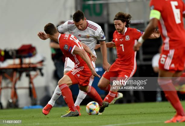 Wales' defender defender James Lawrence and midfielder Joe Allen vie with Hungary's forward Adam Szalai during the UEFA Euro 2020 qualifier Group E...