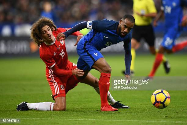 Wales' defender Ethan Ampadu and France's forward Alexandre Lacazette eye the ball during the friendly football match between France and Wales at the...