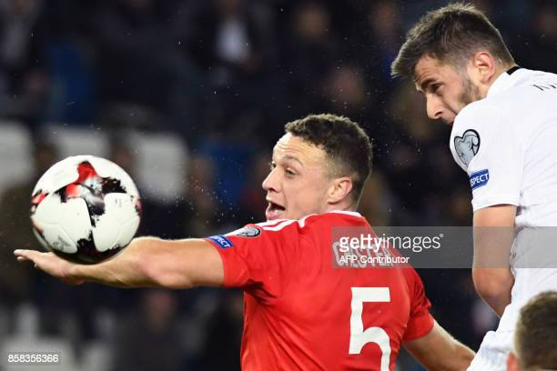 Wales' defender James Chester and Georgia's forward Giorgi Kvilitaia vie for the ball during the FIFA World Cup 2018 qualification football match...