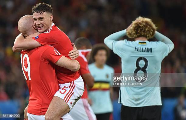Wales' defender James Chester and Wales' defender James Collins celebrate at the end of the Euro 2016 quarterfinal football match between Wales and...