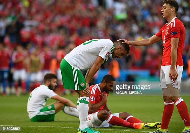 Wales' defender James Chester greets Northern Ireland's defender Aaron Hughes after Wales' victory during the Euro 2016 round of sixteen football...