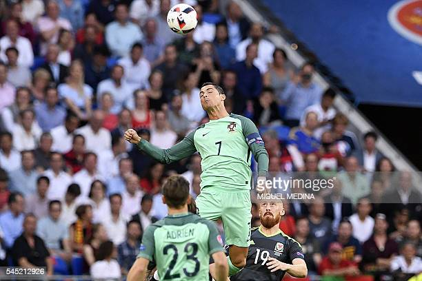 Wales' defender James Collins eyes the ball as Portugal's forward Cristiano Ronaldo heads it during the Euro 2016 semifinal football match between...