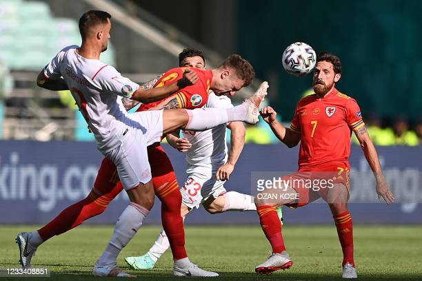 Wales' defender Joe Rodon vies for the ball with his head as Switzerland's forward Haris Seferovic tries to reach it with his foot during the UEFA...