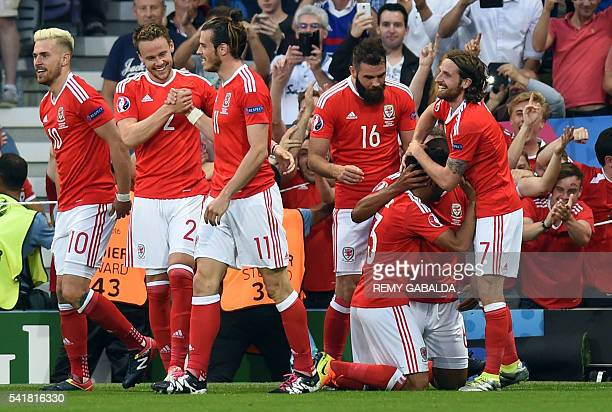 Wales' defender Neil Taylor celebrates the teams second goal with Wales' defender Ashley Williams and Wales' midfielder Joe Allen as Wales' forward...