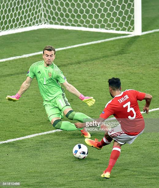 Wales' defender Neil Taylor scores the team's second goal against Russia's goalkeeper Igor Akinfeev during the Euro 2016 group B football match...