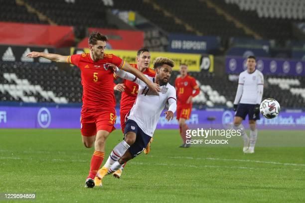 Wales' defender Tom Lockyer vies for the ball against United States' striker Konrad De la Fuente during the international friendly football match...