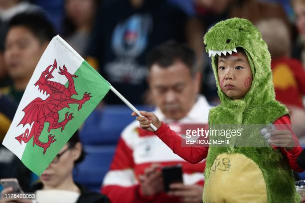 Wales fan awaits the start of the Japan 2019 Rugby World Cup semi-final match between Wales and South Africa at the International Stadium Yokohama in...