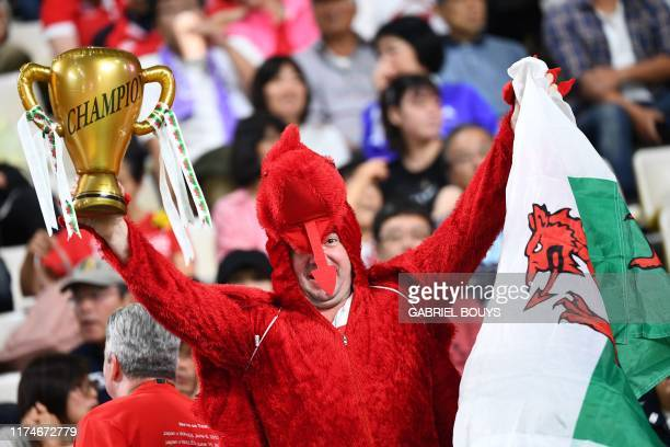A Wales fan awaits the start of the Japan 2019 Rugby World Cup Pool D match between Wales and Fiji at the Oita Stadium in Oita on October 9 2019