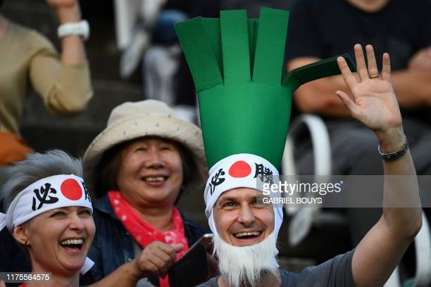 A Wales fan awaits the start of the Japan 2019 Rugby World Cup Pool D match between Wales and Uruguay at the Kumamoto Stadium in Kumamoto on October...