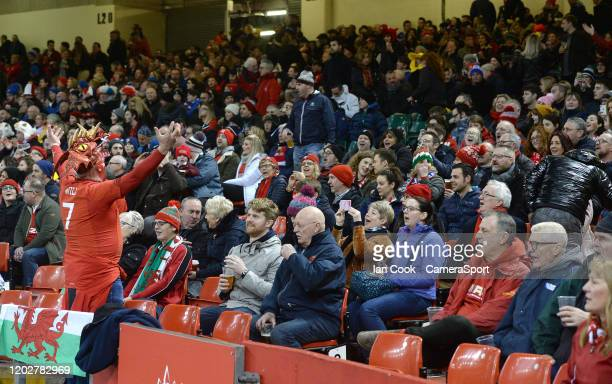 Wales fan pretends to conduct the crowd singing prior to kick off during the 2020 Guinness Six Nations match between Wales and France at Principality...