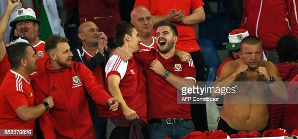 Wales' fans celebrate after the FIFA World Cup 2018 qualification football match between Georgia and Wales in Tbilisi on October 6 2017 / AFP PHOTO /...
