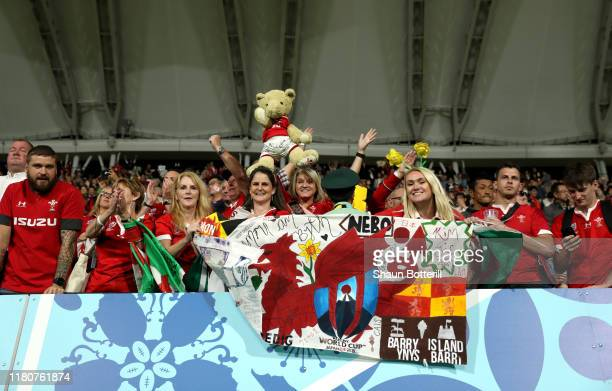 Wales fans celebrate after the Rugby World Cup 2019 Group D game between Wales and Uruguay at Kumamoto Stadium on October 13 2019 in Kumamoto Japan