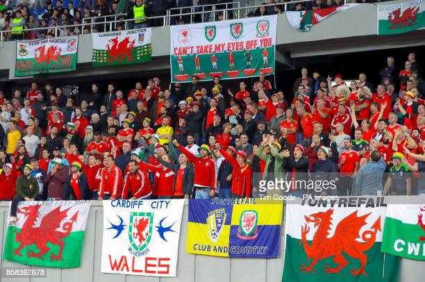 Wales fans celebrate their sides first goal of the match during the 2018 FIFA World Cup Qualifying Group D match at the Boris Paichadze Dinamo Arena...